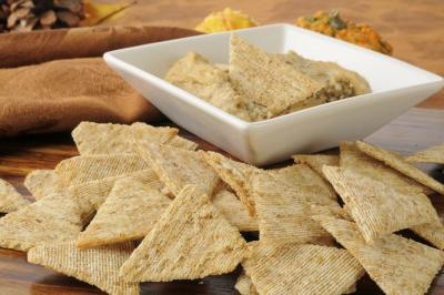 Whole wheat crackers with hummus keeps it lean and healthy. Great before bedtime